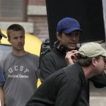 "Director, Nat Christian (in blue Cap) - Lining up a shot on the set of ""FOR HEAVEN'S SAKE"""